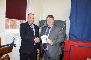 Mr. Payne is presented with a £150 Amazon voucher by Stage Systems Business Manager, Ian